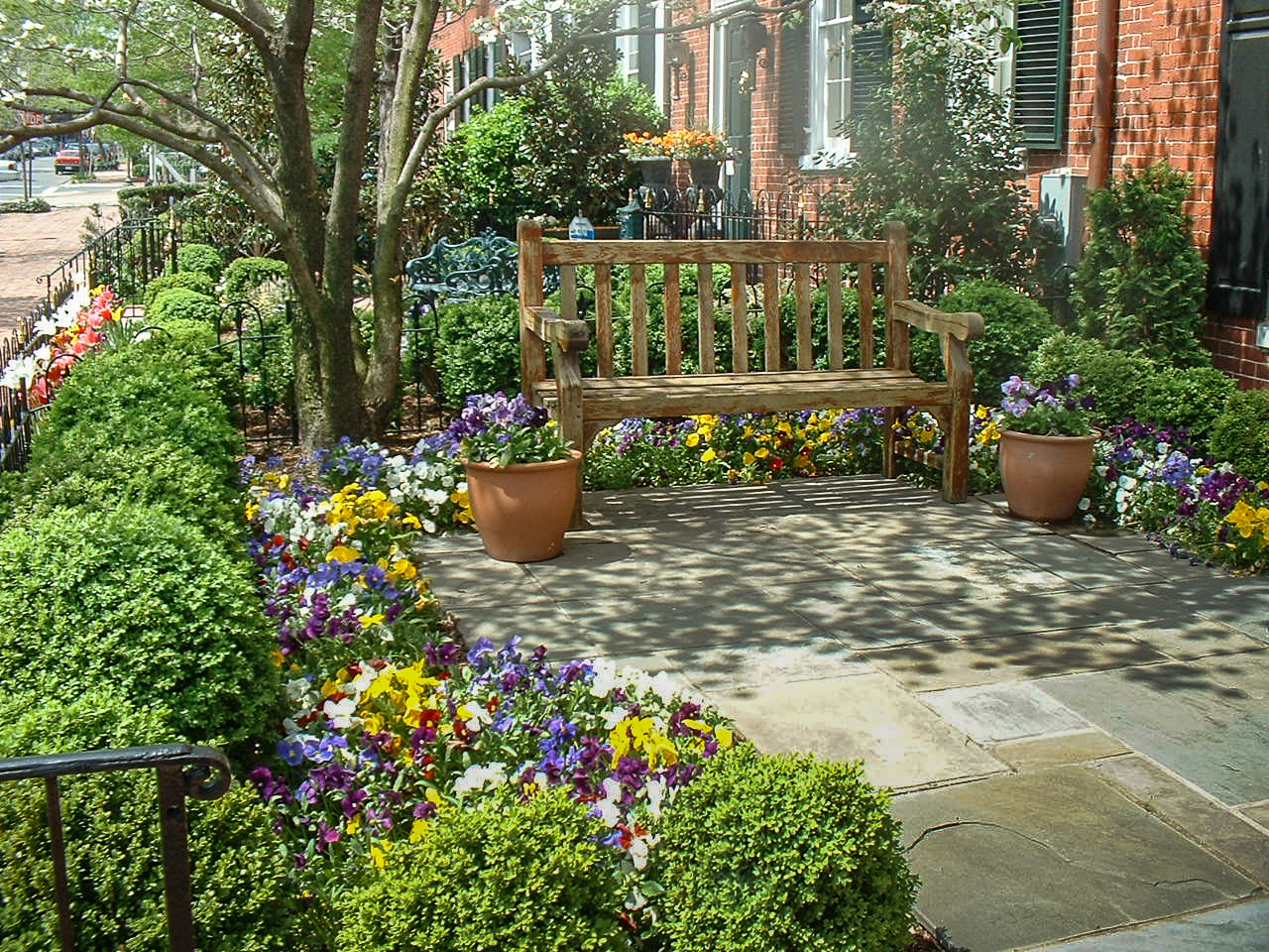 An Inviting Front Yard Patio With Annuals, Boxwoods And A Seating Bench In  Georgetown.