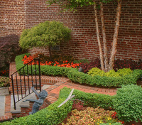 Meticulous pruning and annual rotations makes this formal garden stunning.