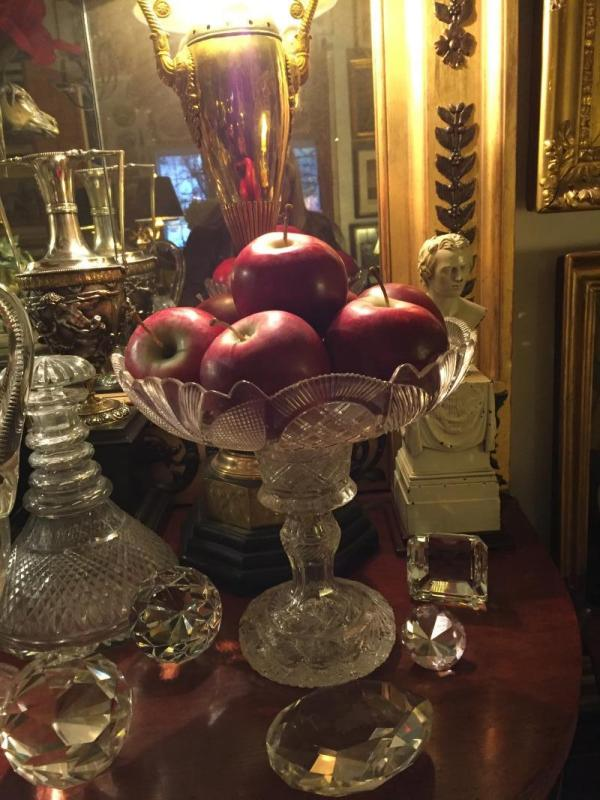 Faux apples in a crystal compote