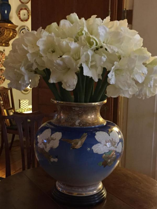 Faux amaryllis stems in an antique Chinese vase